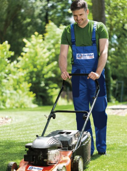 29942656 - man in work overalls mowing lawn, vertical